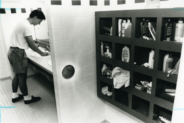 New Brown college senior washes hands in  renovated men's room 1994 by Bernard Yoo