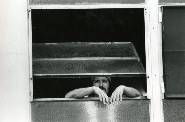 Guy looking out gym window nd 70s  065